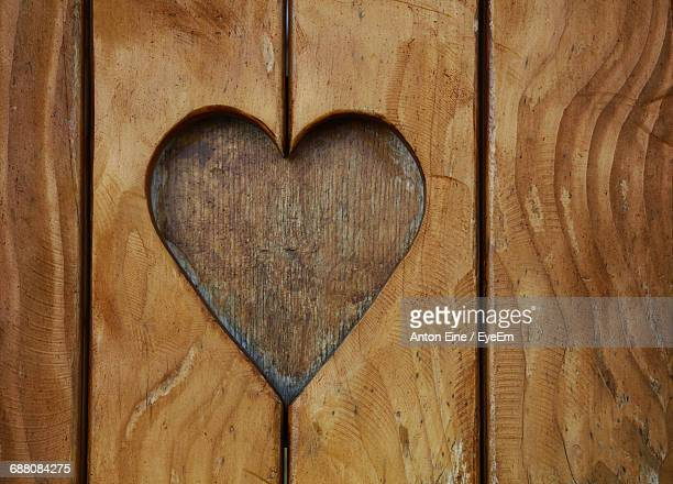 Heart Shape Carved On Wooden Plank
