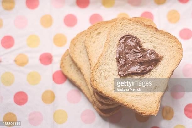Heart shape chocolate spread poker of bread