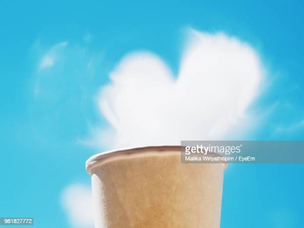 Heart Shape Cloud Over Disposable Cup