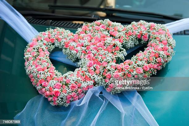 Heart Shape Decoration Made From Flowers On Car Hood During Wedding