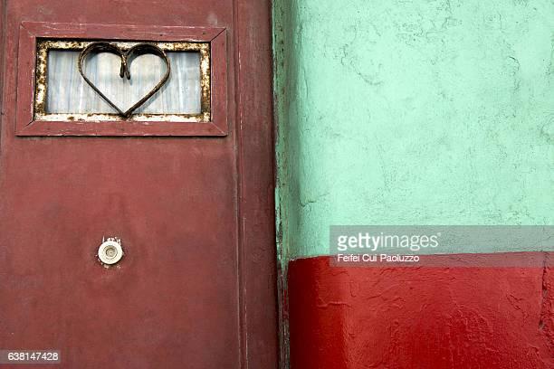 Heart shape decoration on a door at Centro Havana in Cuba