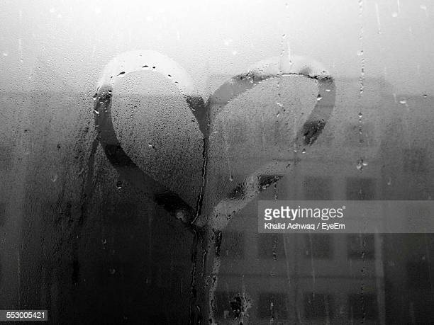 Heart Shape Drawn In Condensation Of Window