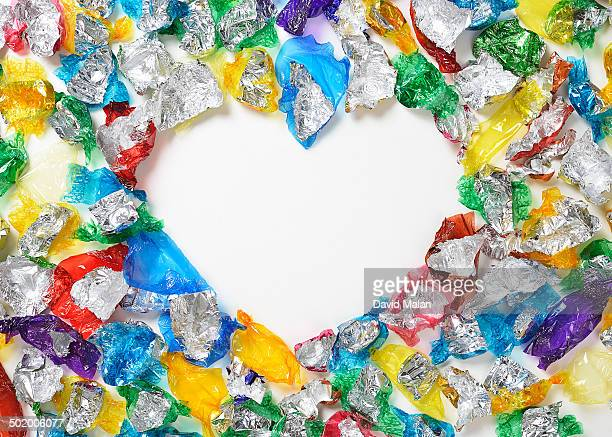 Heart shape formed by sweet wrappers