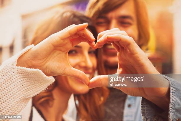 heart shape from couple hands, istanbul - valentines day couple stock pictures, royalty-free photos & images