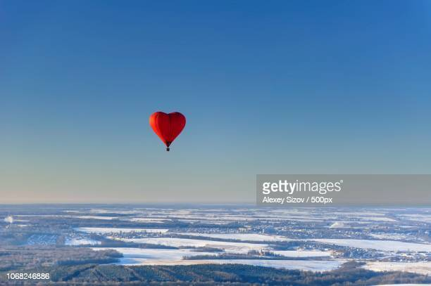 Heart shape hot air balloon in air