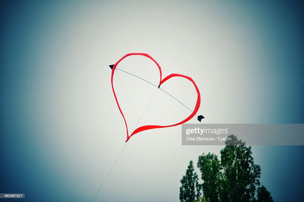 Heart Shape Kite Flying In Mid Air : Stock Photo