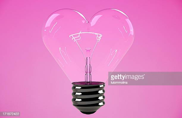 heart shape light bulb - heart month stock photos and pictures
