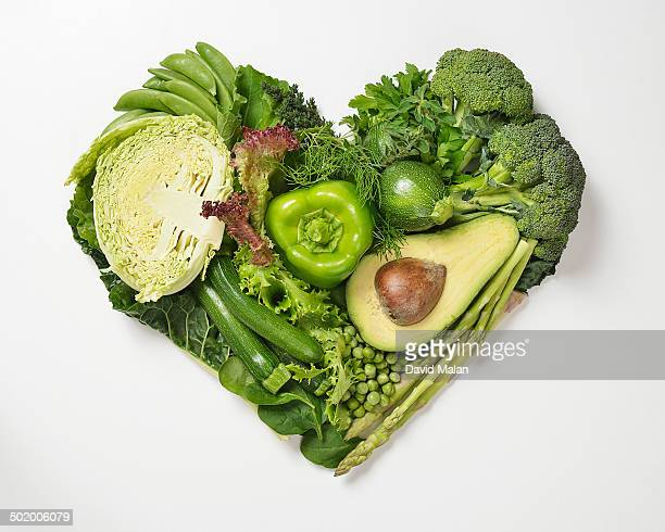 Heart shape made by green fruit & vegetables