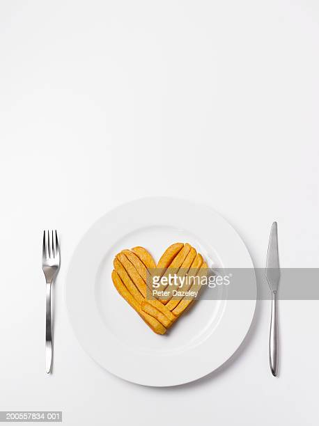 Heart shape made from chips on plate, overhead view