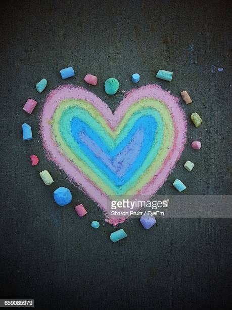 Heart Shape Made Of Colorful Chalk On Street