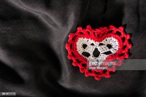 heart shape made of red textile - animal internal organ stock photos and pictures