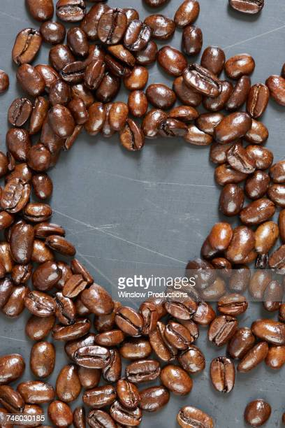 Heart shape made of roasted coffee beans