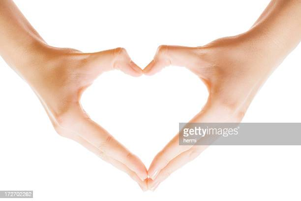 heart shape made of two beautiful palms - hand sign stock pictures, royalty-free photos & images
