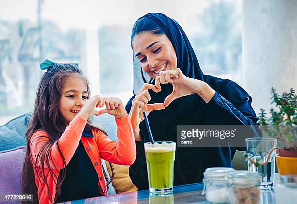 heart shape made with hands - united arab emirates stock pictures, royalty-free photos & images