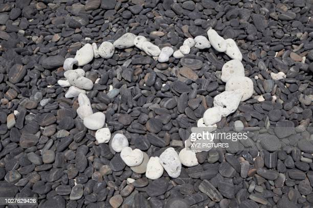 A heart shape made with some of the few white pebbles available on Ko Hin Ngam island, Tarutao National Marine Park, Thailand