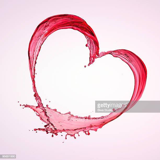 Heart shape of red splash water