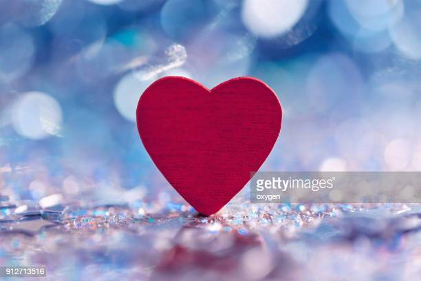 Heart shape on book with bokeh background for valentines day