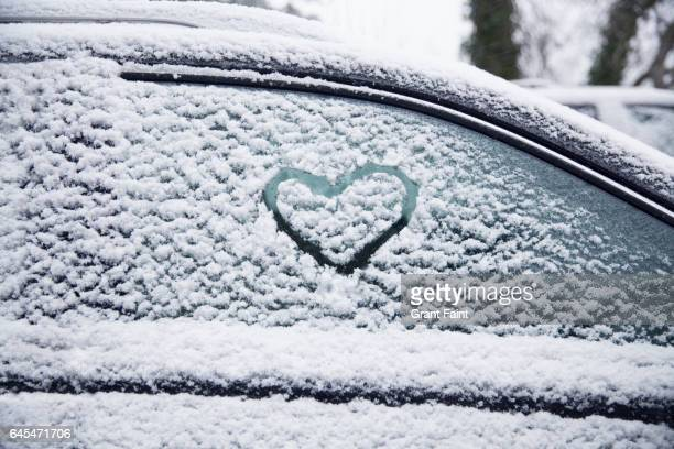 Heart shape on car window.