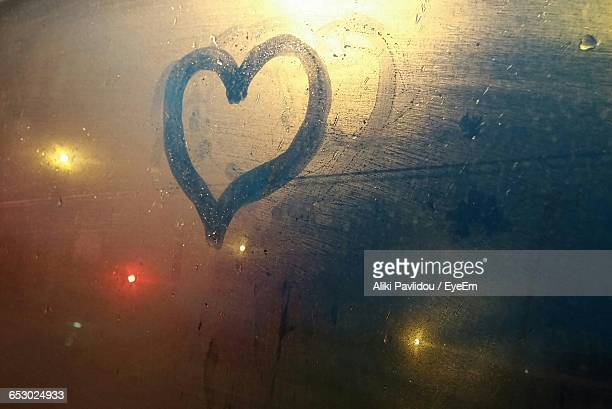 Heart Shape On Condensed Glass Window Of Car At Night