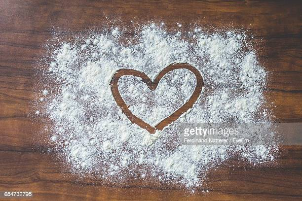 Heart Shape On Flour In Kitchen