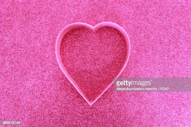 Heart shape on pink background