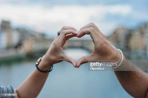 heart shape symbol with hands in florence, italy - heart shape stock pictures, royalty-free photos & images