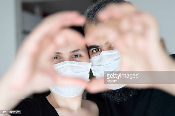 heart shape with mask - illness prevention stock pictures, royalty-free photos & images