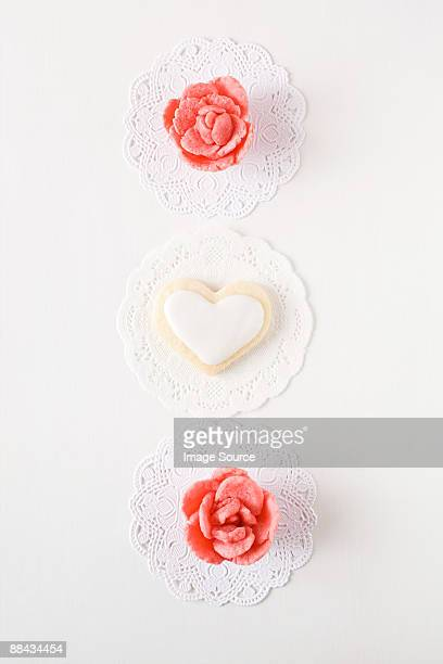 heart shaped biscuit and sweets - doily stock photos and pictures