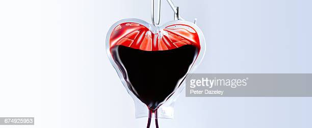 heart shaped blood bag close up - bloody heart stockfoto's en -beelden