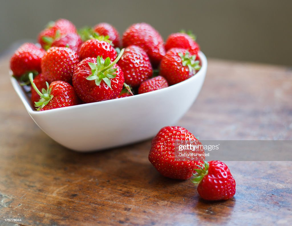 Heart shaped bowl of strawberries : Stock Photo