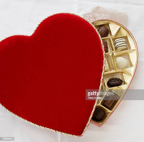 heart shaped box of candy - box of chocolate stock pictures, royalty-free photos & images