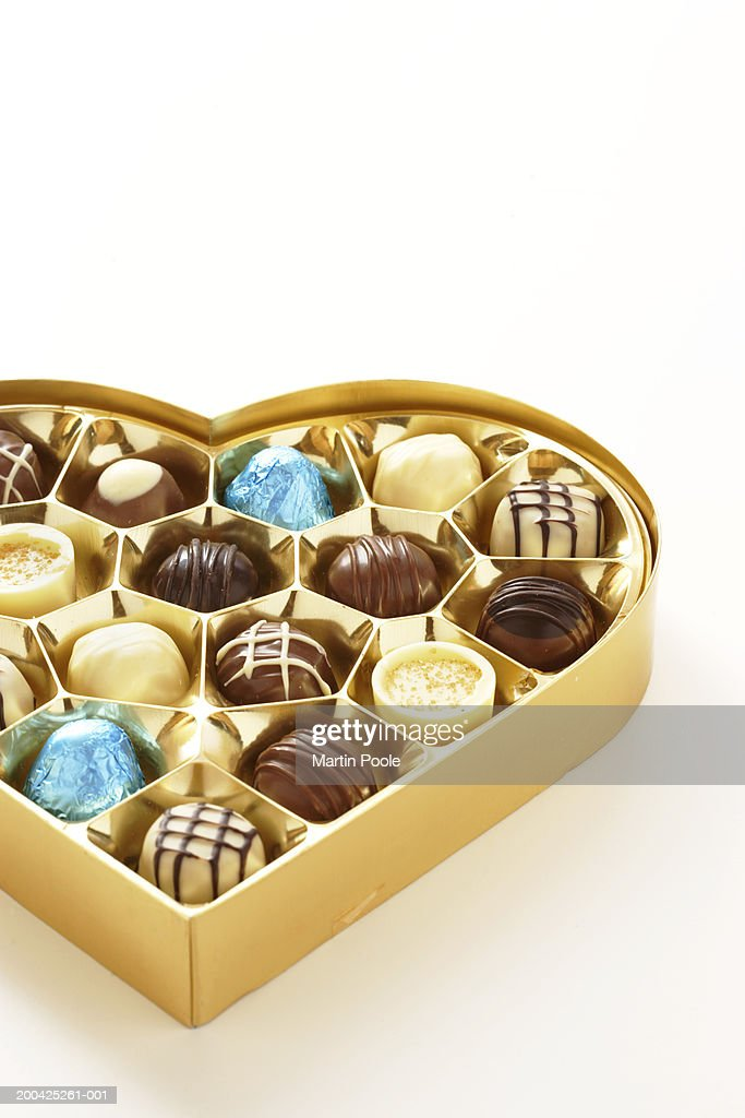Heart shaped box of chocolates, close-up : Stock Photo