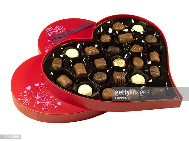 Heart shaped box of chocolates on white