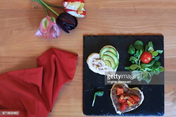 Heart shaped burger with beef, marinated bell peppers, mushroom and avocado.