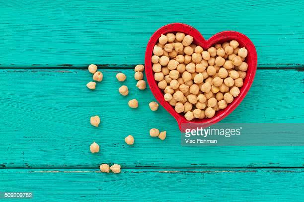 Heart shaped ceramic bowl with chick peas