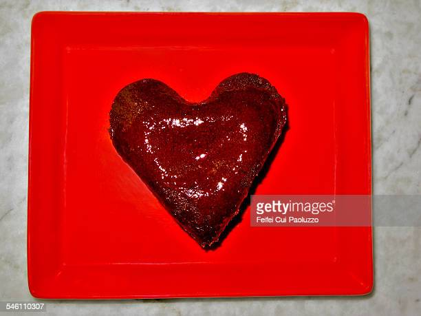 Heart shaped chocolate in a red plate