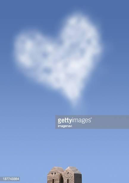 Heart shaped cloud and miniature house
