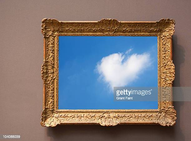 Heart shaped cloud photograph in frame
