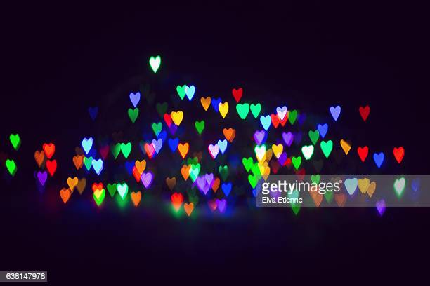 Heart shaped colorful lights of Bokeh against a dark background