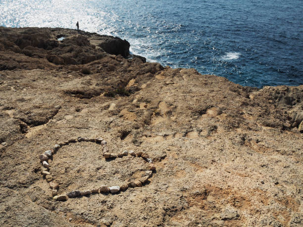 Heart Shaped Composition Made With Stones On Atlantis Beach, Ibiza