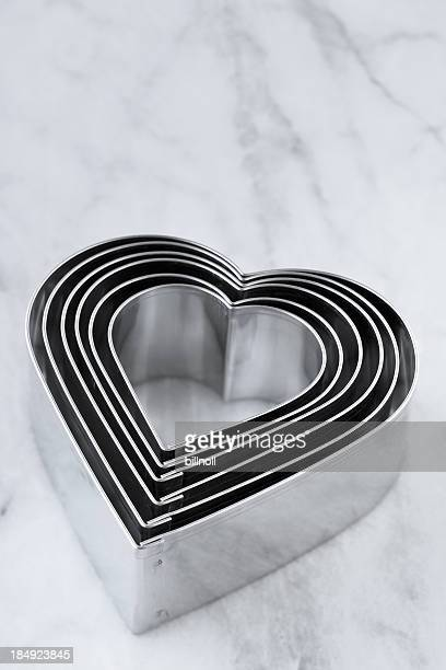 Heart shaped cookie cutters on marble