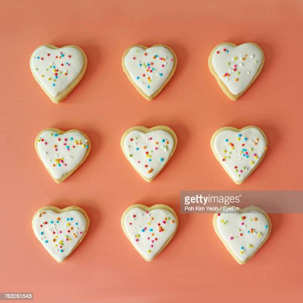 Heart Shaped Cookies Against Orange Background