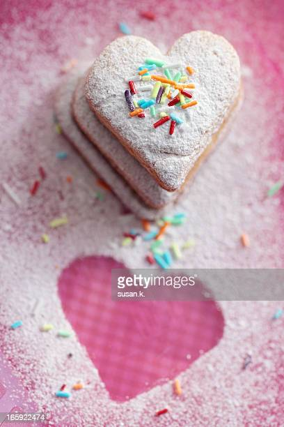 Heart shaped cookies covered with sugar.