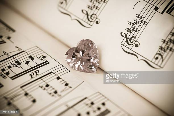 Heart shaped cubic zirconia & music sheet