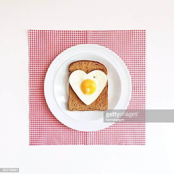 Heart shaped egg on slice of toast