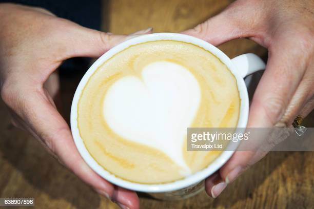 Heart shaped froth on cappuccino coffee
