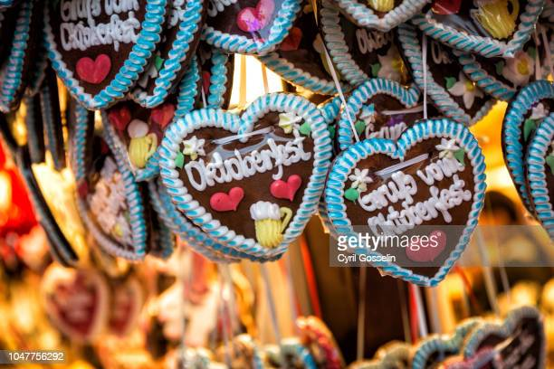 heart shaped german lebkuchen candies at the oktoberfest - oktoberfest stock pictures, royalty-free photos & images