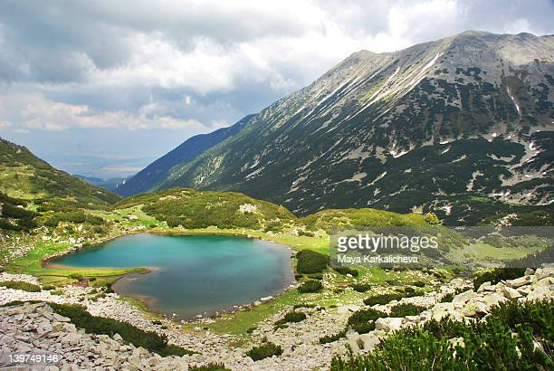 heart shaped glacial lake in summer mountain - pirin national park stock pictures, royalty-free photos & images