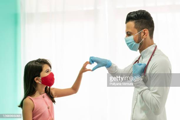 heart shaped hands with doctor - latin american and hispanic ethnicity stock pictures, royalty-free photos & images