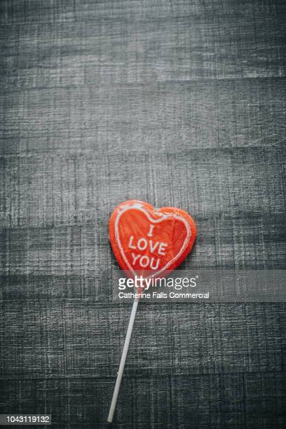 heart shaped lollipop - i love you stock pictures, royalty-free photos & images